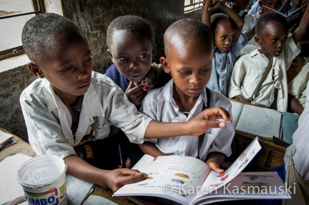 School children at the Maroroni Elementary school look over the text books donated to them by the trekking group.