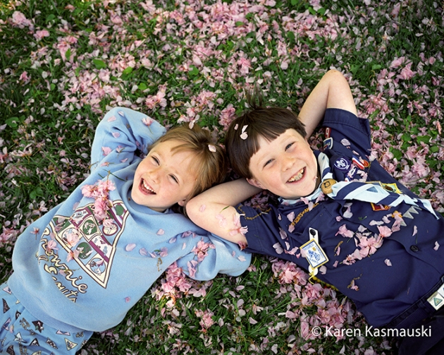 Katie, 7, and Will, 9, posing for their annual Cherry tree portrait.
