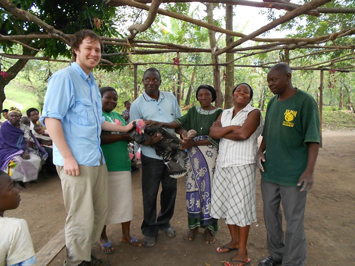 My son, far left, receiving a turkey as a gift during a site visit. Family Photo
