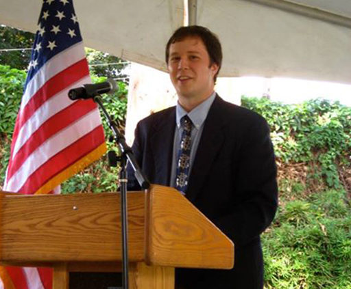 My son giving a talk during the swearing in ceremony of new Peace Corps volunteers in Uganda.