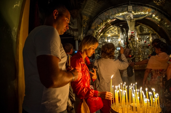 Pilgrims visit the Church of the Holy Sepulchre where Christians believe Christ was crucified, died and rose from the dead.