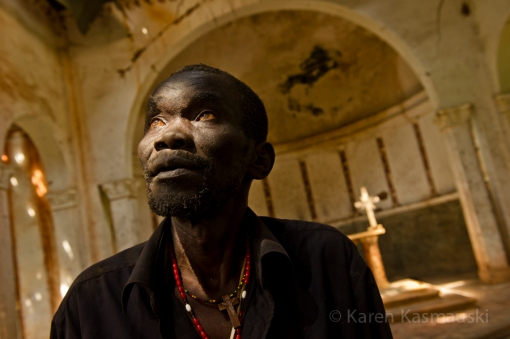Paustino Jada, the catechist  of the Palotaka Church in South Sudan looks up at the damage ceiling.