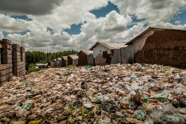 Nearly every open space throughout Kiambiu in Nariobi, Kenya is often covered with trash.