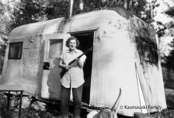 My grandmother Genevieve   at a hunting trailer in Michigan in 1954.