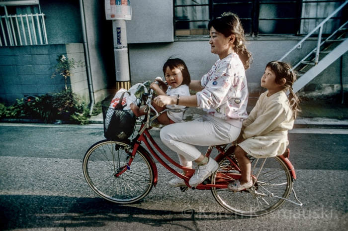 A housewife carries her children to a tutoring class, from the 1990, National Geographic story on Japanese Women.