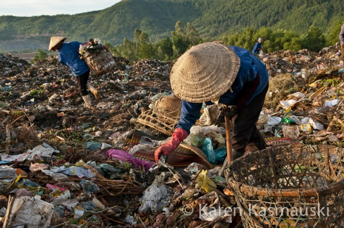 People living and working on a garbage dump outside of Danang. Hundreds of people depend on finding stuff thrown away by others to recycle or sell.