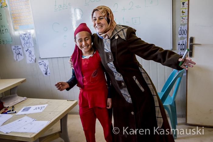 Jamalat, herself a refugee,  was a teacher in Syria.  She teaches the younger students with warmth and ethusiasm