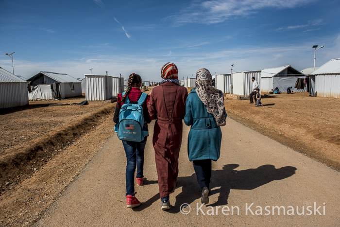 High school students walk back to their temporary homes in the Azraq Refugee Camp