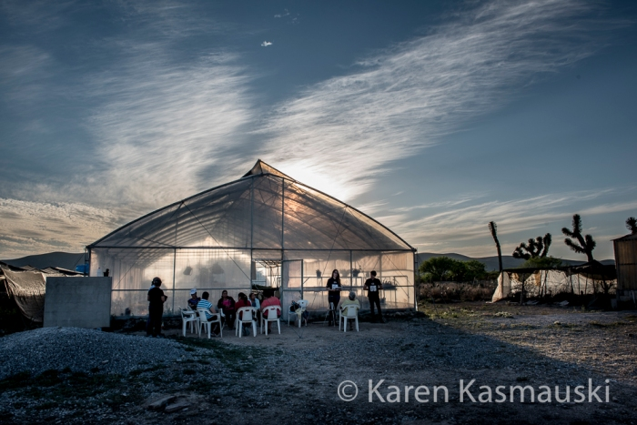Sun sets behind the greenhouse where the women's group, las rosas del ejido, grow cacti.